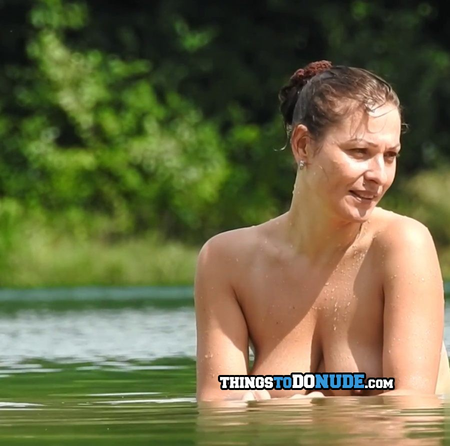 Gorgeous naked milf with natural big tits is sitting inside water